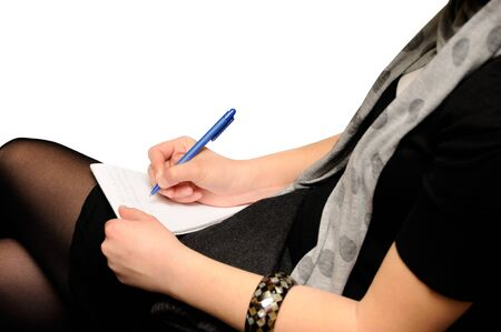 Woman writing in document photo