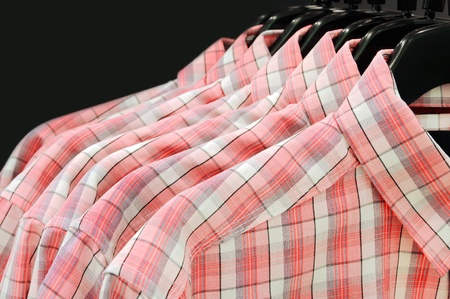 Clothes hanger with shirts isolated Stock Photo - 9870868