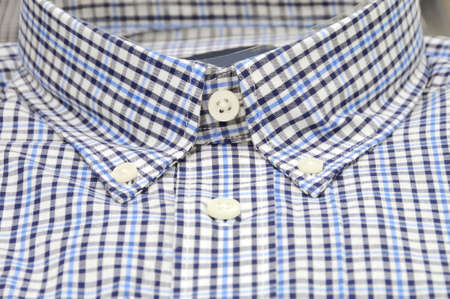 Nicely folded men shirt with focus on the collar  photo