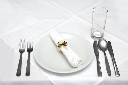 Celebration table with basic cutlery and glass prepared Stock Photo