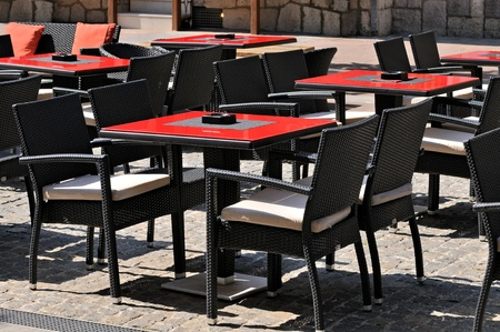 Empty tables and chairs in a outdoor cafe