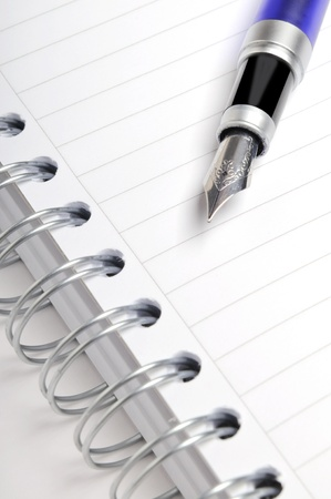 creative writer: Fountain pen on notebook Stock Photo