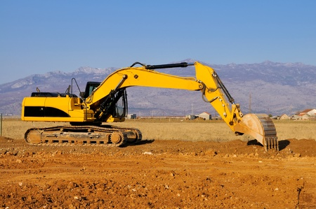worksite: Excavator in the action Stock Photo