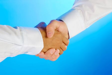 Two businessman shaking hands photo