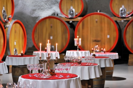 Celebration in the big wine cellar Stock Photo