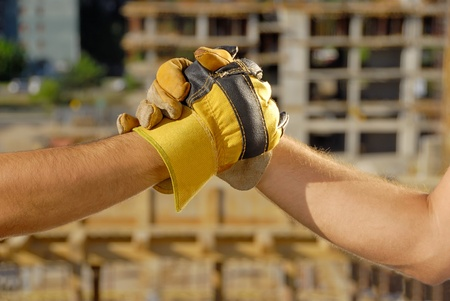 Handshake over building site Stock Photo - 12363520