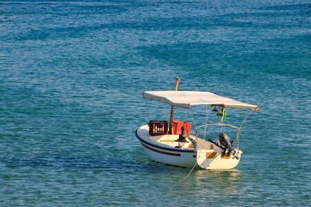 Fishing boat on a sunny day photo