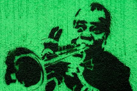 Trumpeter graffiti green photo