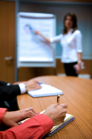 Business people hands holding pens and papers near table at business seminar, unrecognizable people  Stock Photo