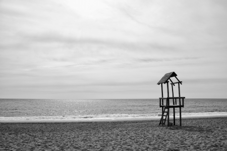 lifeguard tower: Lifeguard wooden beach observation tower, black and white