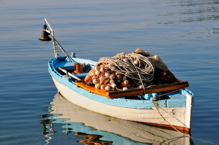 fishing net: Small fishing boat with fishing net and equipment
