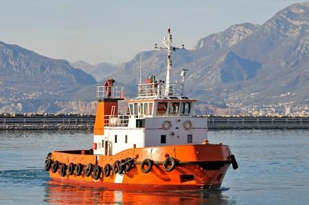 tug boat: Orange tugboat