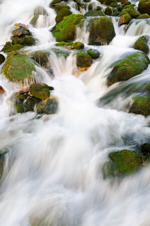 Water flowing over rocks photo