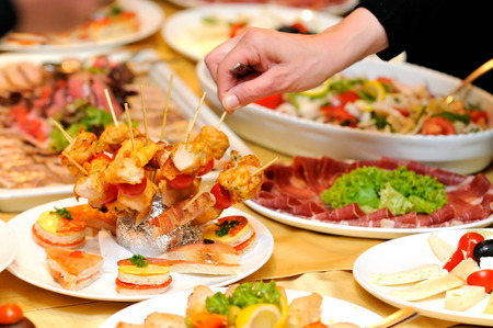 buffet table: Human taking food on the party