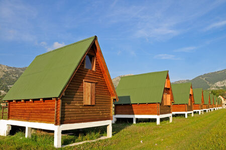 Log cabins in the row