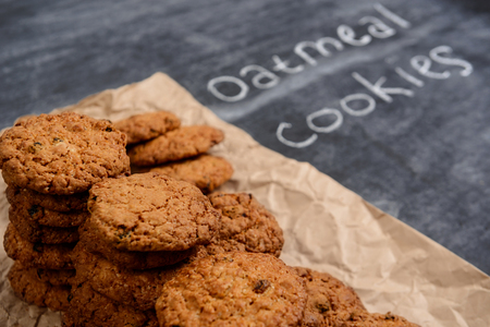 Sweet oatmeal cookies on gray wooden table Stock Photo
