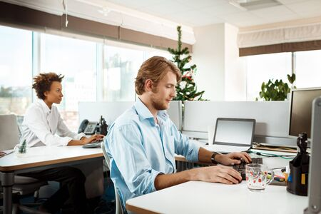 Colleagues working in office on christmas day. Copy space. Stock Photo
