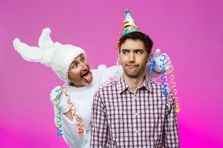 hallucinations: Drunk man and rabbit at birthday party over purple background.