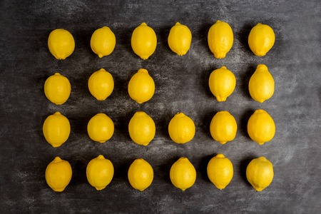 pedant: Picture of lemons on grey background. Macro.