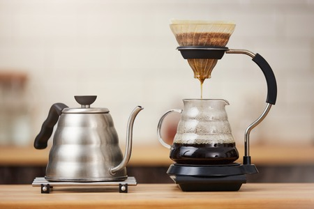 Close up of coffee brewing gadgets on wooden bar counter. Stock Photo