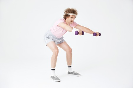 Side view of man doing squats, building muscles, training hard
