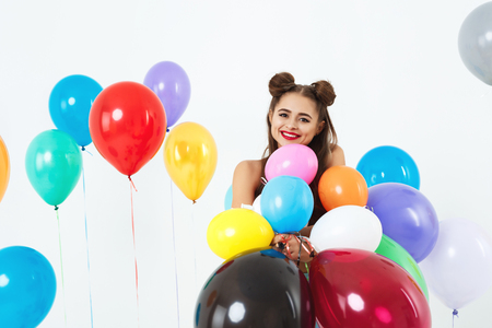 teeny: Woman in 60s, 70s style clothing posing with colourful balloons