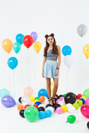 teeny: Nice teen girl in cool summer outfut posing with balloons
