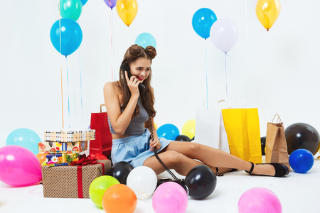 Portrait of young happy woman talking on phone, receiving wishes Stock Photo