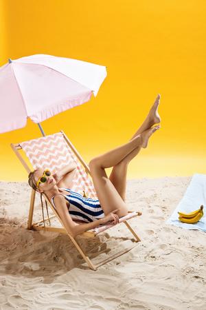 smoky black: Teen girl posing in fancy bath suit on summer background