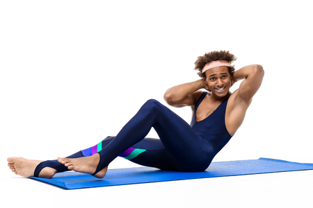 Sportive african man training on karemat over white background.