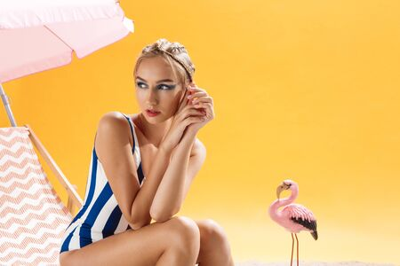 smoky black: Pretty fashion model wearing swimsuit on summer decor looing away
