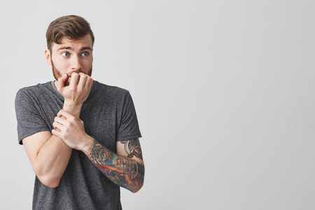 Young Unhappy Bearded Tattooed European Man With Fashionable Stock