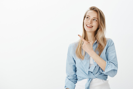 feminine woman with blond hair in stylish outfit.