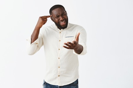 Annoyed confused and displeased good-looking african american in casual outfit, gesturing with palm, rolling index finger over temple, shocked with strange decision of friend Stock Photo - 107406129