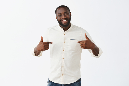 Applause me it was mine effort. Proud happy and pleased good-looking African American guy with beard and short haircut, pointing at himself and smiling broadly, bragging about personal achievements