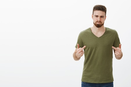Know what, fuck you. Portrait of pissed off angry and offended handsome bearded man having fight with best friend, being betrayed pouting from anger showing middle fingers at camera, frowning furious Stock Photo