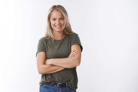 Try bit my record. Portrait of self-assured cheeky young blond caucasian female in olive t-shirt cross hands over body smiling daring and confident, assuring can take everything under control