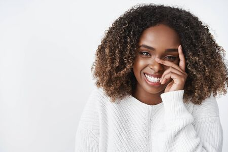 Tenderness, beauty and pure emotions concept. Portrait of sensual tender and cute african american girlfriend in sweater laughing and giggling cute as looking at camera holding fingers on cheek