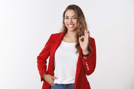 Girl totally confident assured deal already her hands, showing okay ok gesture smiling lucky self-assured holding hand pocket. Successful businesswoman happy everything alright