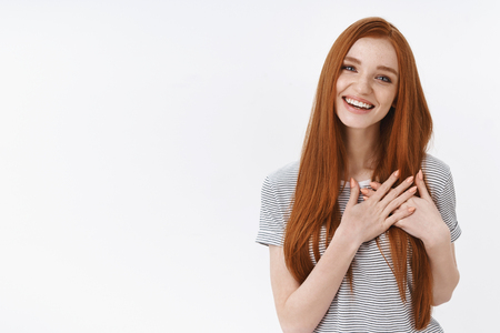 Charming lively tender feminine young redhead girl flirting look pleased laughing joyfully hold palms pressed chest heartwarming gesture touched, delighted sincerely smiling