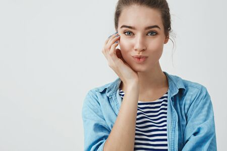 Close-up charming good-looking young mother taking skincare, smiling happy visiting beauty salon done nails, folding lips silly cute, touching cheek, having lucky fantastic day, white background