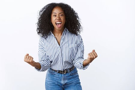Wild excited overwhelmed attractive african american woman shout out loud happily Imagens