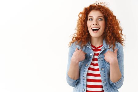 Waist-up surprised impressed redhead stylish feminine ginger girl 25s curly hairstyle pointing herself amazed bragging accomplishment achieve awesome opportunity standing white background