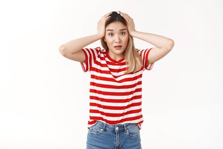 Perplexed young asian blond girl grab head panicking confused what do look camera worried facing terrible situation nervously reacting bad news gasping anxious, standing white background Фото со стока