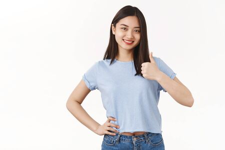 Only positive answer have my approval. Cheerful optimistic energized asian positive girl show thumb up smiling like satisfied delighted friends cool choice great decision, congratulating good job