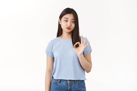 Well ok. Reluctant indifferent bothered asian brunette daughter sighing show okay fine gesture unimpressed agree only mom to leave alone standing white background lacking interest white background