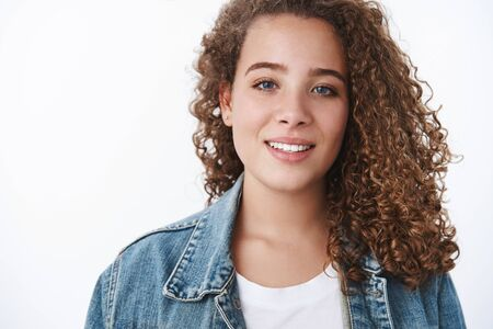 Attractive feminine tender young woman curly-haired chubby smiling silly look camera blue eyes girlfriend attend first date liking spend time together boyfriend have fun look happy white background