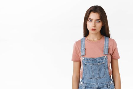 Troubled and worried, annoyed serious-looking girl gonna exploud from anger, standing pissed and stare camera ready to punch someone in face, pose over white background distressed and pressured