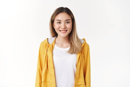 Waist-up sociable friendly charming asian blond girl wear stylish yellow jacket t-shirt smiling broadly determined have good time perfect summer weekend grinning toothy good mood white background Stok Fotoğraf