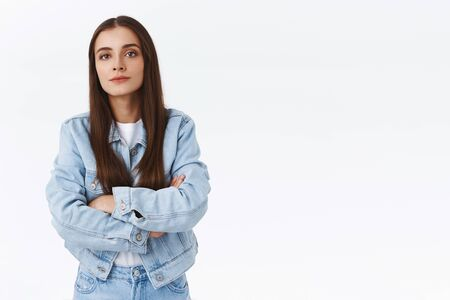 Offended serious-looking sulking brunette girl, cross hands over chest look arrogant and snobbish, standing insulted with upset, bothered expression, posing annoyed over white background
